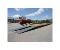Weighbridges with side guides