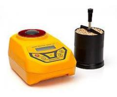 Portable moisture meter for dry grains